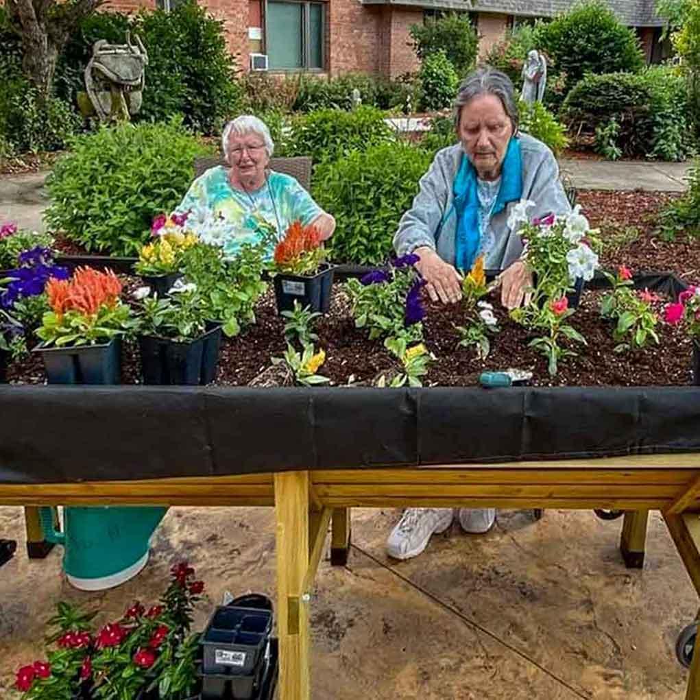 Residents and Volunteers Planting Flowers